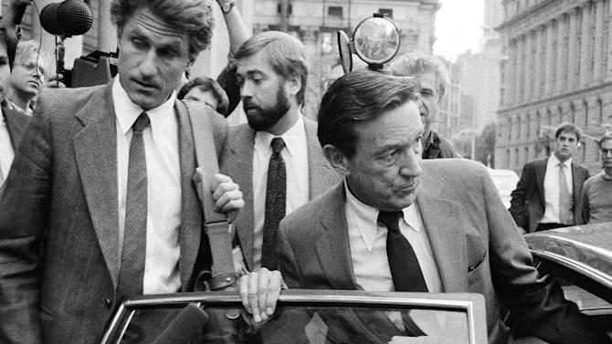 "FILE - In this Oct. 15, 1984 file photo, CBS-TV Correspondent Mike Wallace, right, and producer George Crile, left, leave U.S. District Court in New York, after attending the trial of a libel suit brought by former Gen. William C. Westmoreland against CBS -TV. Wallace, the dogged, merciless reporter and interviewer who took on politicians, celebrities and other public figures in a 60-year career highlighted by the on-air confrontations that helped make ""60 Minutes"" the most successful primetime television news program ever, has died. He was 93. (AP Photo/Mario Suriani, File)"