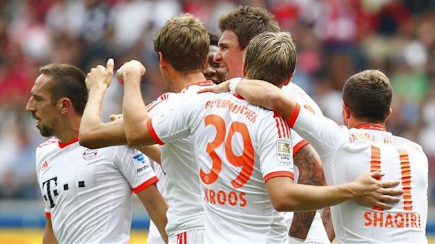 Mario Mandzukic (3rd R), Toni Kroos (2nd R) and Franck Ribery (L) of Bayern Munich celebrate Mandzukic's goal against Eintracht Frankfurt during their German first division Bundesliga soccer match in Frankfurt, August 17, 2013. (Reuters)