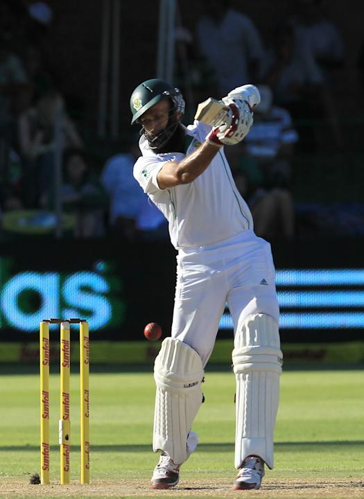South Africa's batsman Hashim Amla, plays a shot on the third day of their 2nd cricket test match against Australia at St George's Park in Port Elizabeth, South Africa, Saturday, Feb. 22, 2014