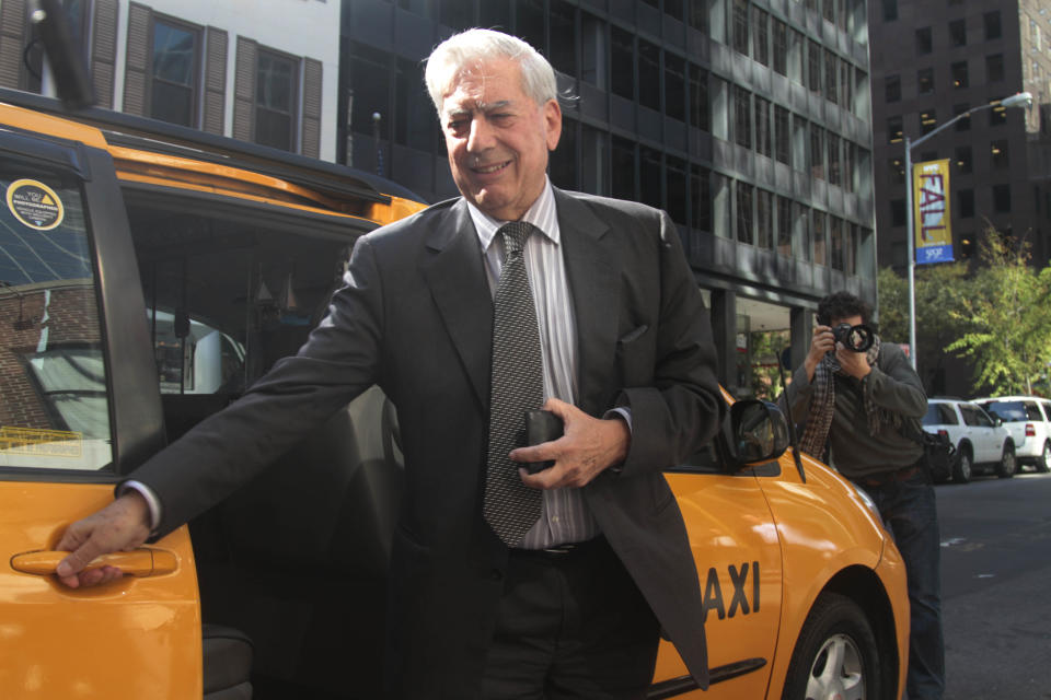 Peruvian Mario Vargas Llosa, arrives for an interview in New York after winning the 2010 Nobel Prize in literature on Thursday, Oct. 7, 2010.  (AP Photo/Bebeto Matthews)