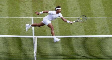 Rafael Nadal of Spain hits a shot during his match against Dustin Brown of Germany at the Wimbledon Tennis Championships in London