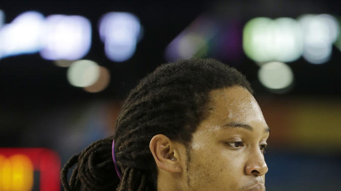 Florida Gulf Coast's Sherwood Brown (25) reacts in the final moments against Florida during a regional semifinal game in the NCAA college basketball tournament, Saturday, March 30, 2013, in Arlington, Texas. Florida won 62-50. (AP Photo/David J. Phillip)