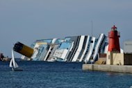 The stranded Costa Concordia cruise ship lies near the harbour of Giglio Porto in June 2012. Europe's top cruise operator has come under pressure at pre-trial hearings into the Costa Concordia disaster as captain Francesco Schettino faced survivors for the first time