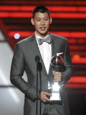 New York Knicks guard Jeremy Lin accepts the award for best breakthrough athlete at the ESPY Awards on Wednesday, July 11, 2012, in Los Angeles. (Photo by John Shearer/Invision/AP)