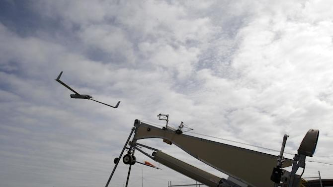 This photo taken March 26, 2013, shows an Insitu ScanEagle unmanned aircraft launched at the airport in Arlington, Ore.  It's a good bet that in the not-so-distant future aerial drones will be part of Americans' everyday lives, performing countless useful functions. A far cry from the killing machines whose missiles incinerate terrorists, these generally small unmanned aircraft will help farmers more precisely apply water and pesticides to crops, saving money and reducing environmental impacts. They'll help police departments to find missing people, reconstruct traffic accidents and act as lookouts for SWAT teams. They'll alert authorities to people stranded on rooftops by hurricanes, and monitor evacuation flows.  (AP Photo/Don Ryan)