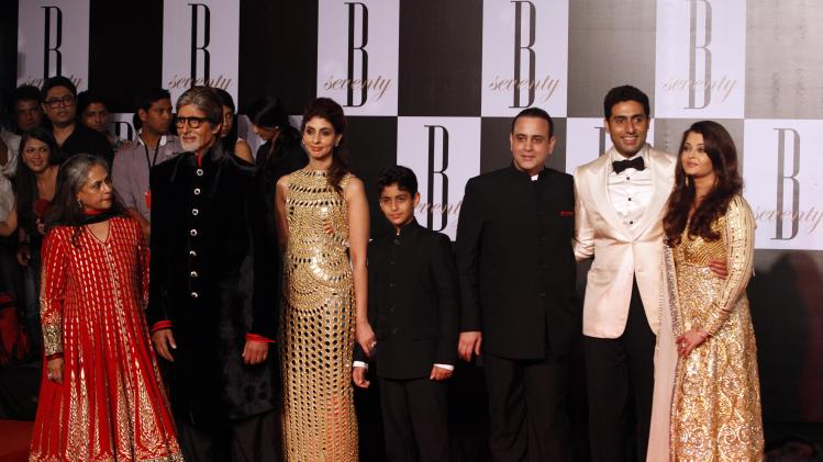 "Bollywood star Amitabh Bachchan, second left, poses for photographers along with family members, wife Jaya Bachchan, left, daughter Shweta Nanda, third left, son-in-law Nikhil Nanda, third right, son Abhishek Bachchan, second right, and daughter-in-law Aishwarya Rai-Bachchan during a party on the eve of his 70th birthday in Mumbai, India, Wednesday, Oct. 10, 2012. Affectionately known as ""Big B,"" Bachchan has acted in around 180 films in a career spanning four decades in Bollywood, the home of India's prolific movie industry. (AP Photo/ Rajanish Kakade)"
