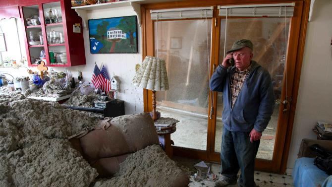 Blaine Lawson, 76, stands inside his house after a reported tornado tore the roof off his home, Friday, March 2, 2012, in Cleveland, Tenn. Neither he nor his wife were injured. (AP Photo/Robert Ray)
