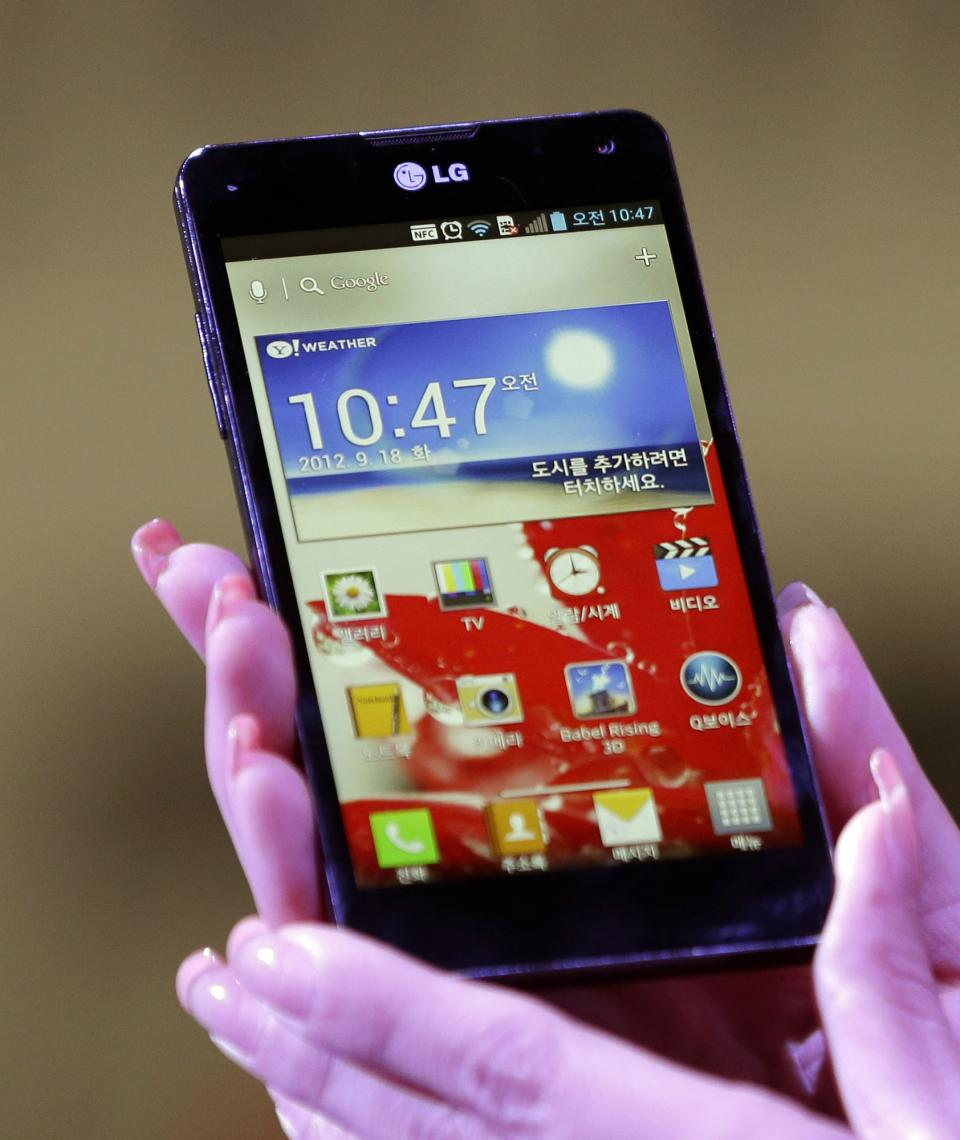 A model holds LG Electronics' new Optimus G smartphone during its unveiling ceremony in Seoul, South Korea, Tuesday, Sept. 18, 2012. LG Electronics will launch the Optimus G smartphone next week in South Korea, pinning hope on the new Android device to help revive its loss-making mobile business. (AP Photo/Lee Jin-man)