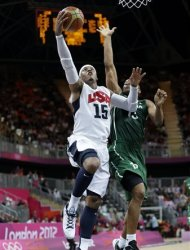 USA's Carmelo Anthony (15) drives to the basket past Nigeria's Derrick Obasohan (13) during a preliminary men's basketball game at the 2012 Summer Olympics, Thursday, Aug. 2, 2012, in London. (AP Photo/Eric Gay)