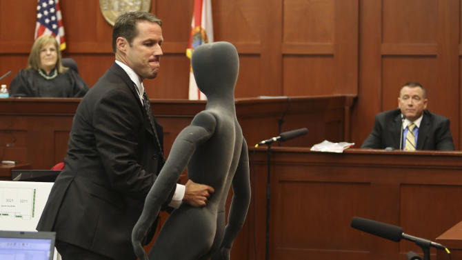 Assistant state attorney John Guy, front center, uses a foam dummy to describe the altercation between George Zimmerman and Trayvon Martin to defense witness and law enforcement expert Dennis Root, right, during Zimmerman's trial in Seminole circuit court in Sanford, Fla. Wednesday, July 10, 2013. Zimmerman has been charged with second-degree murder for the 2012 shooting death of Trayvon Martin. (AP Photo/Orlando Sentinel, Gary W. Green, Pool)