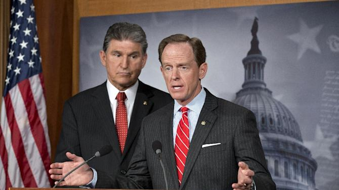 In this April 10, 2013 file photo, Democratic Sen. Joe Manchin of West Virginia, left, and Republican Sen. Patrick Toomey of Pennsylvania, right, announce that they have reached a bipartisan deal on expanding background checks to more gun buyers, at the Capitol in Washington. A bipartisan gun control deal by Toomey and Manchin inspired Senate conservatives to drop their filibuster plans, even though many Republicans who allowed the legislation to advance said they were unlikely to vote for its passage in the end. (AP Photo/J. Scott Applewhite, File)