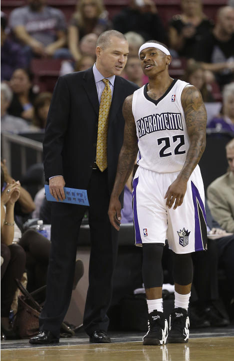 Sacramento Kings head coach Michael Malone talks with Kings guard Isaiah Thomas during the third quarter of an NBA preseason basketball game against the Phoenix Suns in Sacramento, Calif., Thursday, O