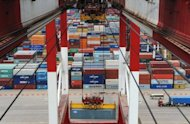 Containers are being loaded at Qingdao port in east China&#39;s Shandong province. China&#39;s manufacturing activity fell to its lowest level in more than three years in August, according to a survey compiled by HSBC