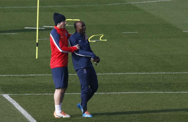 Paris St Germain's assistant coach Claude Makelele and player Maxwell attend a training session at the Camp des Loges training center in Saint-Germain-en-Laye, near Paris