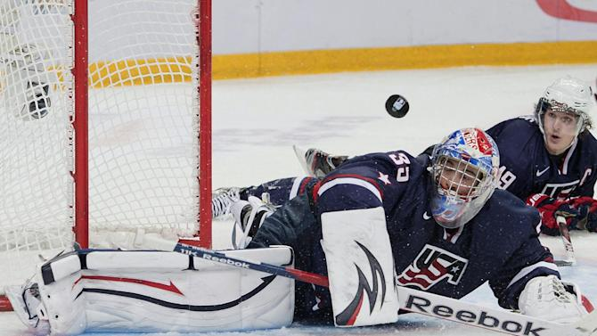 Team USA goalie John Gibson makes eyes the puck during third period action in a semifinal match against Canada at the hockey world junior championships in Ufa, Russia on Thursday, Jan. 3, 2013. (AP Photo/The Canadian Press, Nathan Denette)