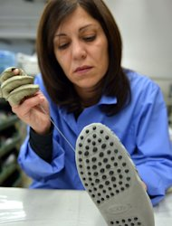 A worker sews moccasins in the Tod's workshop on May 27, 2013 in Casette d'Ete, Italy. Harrison Ford, Princess Caroline of Monaco and Brad Pitt -- as well as countless of the newly rich in places like Brazil and China -- are among the wealthy foreign clients that are boosting sales