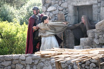 One of King Herod's soldiers comes to claim a young girl from her family who cannot pay their taxes in New Line Cinema's The Nativity Story