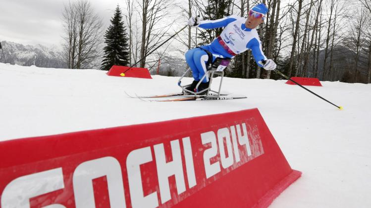 Italy's Giordano Tomasoni skis during the men's 15 km cross-country sitting at the 2014 Sochi Paralympic Winter Games in Rosa Khutor