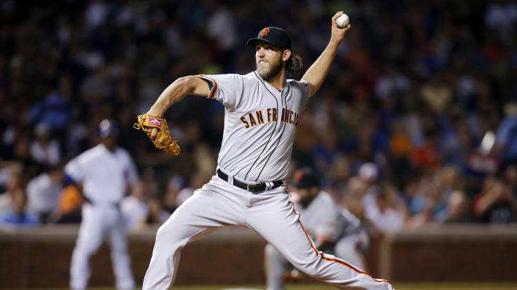 San Francisco Giants starting pitcher Madison Bumgarner delivers against the Chicago Cubs during the first inning of a baseball game on Thursday, Aug. 21, 2014, in Chicago. (AP Photo/Andrew A. Nelles)