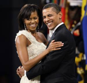 """FILE - In this Jan. 20, 2009, file photo, President Barack Obama and first lady Michelle Obama dance at the Western Inaugural Ball in Washington. Turning 50 is hard enough. But it's got to be even harder when you're president, because the whole world knows about it. """"I feel real good about 5-0,"""" he said. """"I've gotten a little grayer since I took this job but otherwise, I feel pretty good."""" Obama added that Michelle has told him that she still thinks """"I'm cute.""""  (AP Photo/Charlie Neibergall, File)"""