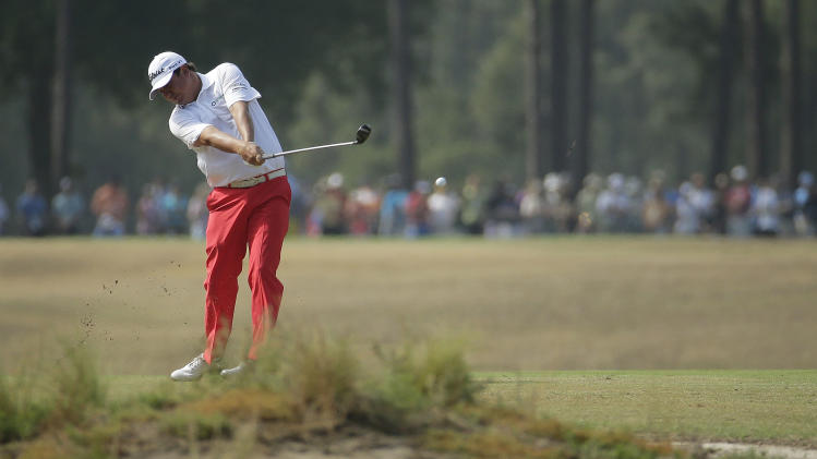Jason Dufner hits from the fairway on the 16th hole during the second round of the U.S. Open golf tournament in Pinehurst, N.C., Friday, June 13, 2014