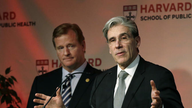 Dr. Julio Frenk, Dean of the Faculty at the Harvard School of Public Health, speaks as NFL football commissioner Roger Goodell listens, at left, in Boston, Thursday, Nov. 15, 2012. Goodell delivered the Dean's Distinguished Lecture where he discussed some of the rules that have been created to limit concussions in the game of football. Goodell said the league will do what it needs to do to protect the safety of its 1,800 players. (AP Photo/Elise Amendola)
