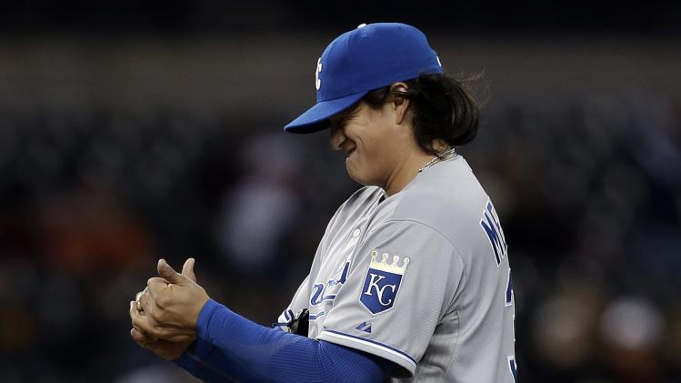 Kansas City Royals pitcher Luis Mendoza reacts after walking Detroit Tigers' Jhonny Peralta with the bases loaded to score Prince FIelder in the fourth inning of a baseball game in Detroit, Wednesday April 24, 2013. (AP Photo/Paul Sancya)