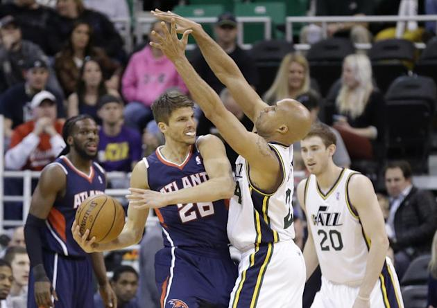 Utah Jazz's Richard Jefferson (24) defends against Atlanta Hawks' Kyle Korver (26) in the first quarter during an NBA basketball game Monday, March 10, 2014, in Salt Lake City