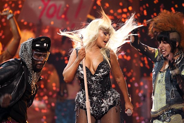 FILE - In this Nov. 18, 2012 file photo, Christina Aguilera performs at the 40th Anniversary American Music Awards in Los Angeles. The Rock and Roll Hall of Fame and Museum announced Wednesday, Jan. 23, 2013, that Aguilera, John Mayer and Jennifer Hudson are among the stars set to perform at the 28th annual Rock and Roll Hall of Fame induction ceremony to be held on April 18, 2013, in Los Angeles. (Photo by Matt Sayles/Invision/AP, File)