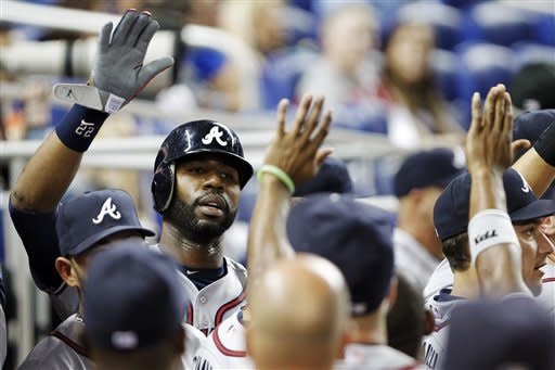 Uggla homers, Braves beat Marlins 7-5