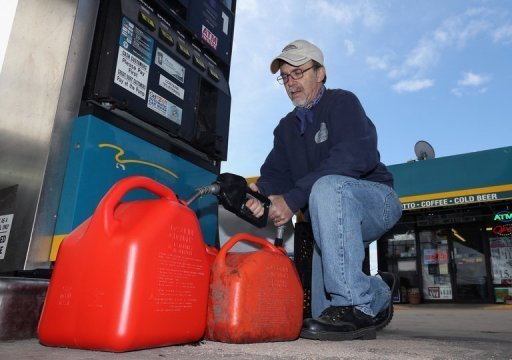 <p>A man fills up gas containers in New York on November 5. Oil prices closed higher Friday as investors grew more optimistic about an improvement in Europe's economic situation and took advantage of a weaker dollar.</p>