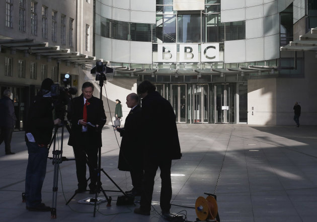 A television crew set up for alive transmission outside the BBC headquarters in London, Sunday, Nov, 11, 2012. The head of the BBC's governing body said Sunday the broadcaster needs a radical overhaul following the resignation of its chief executive in wake of a scandal over a botched report on child sex-abuse allegations. Chris Patten vowed to restore confidence and trust in the BBC, which is reeling from the resignation of George Entwistle and the scandals prompting his ouster. Entwistle resigned Saturday night amid a storm of controversy after a news program wrongly implicated a British politician in a child sex-abuse scandal, deepening a crisis sparked by revelations it decided not to air similar allegations against one of its own stars.(AP Photo/Alastair Grant)