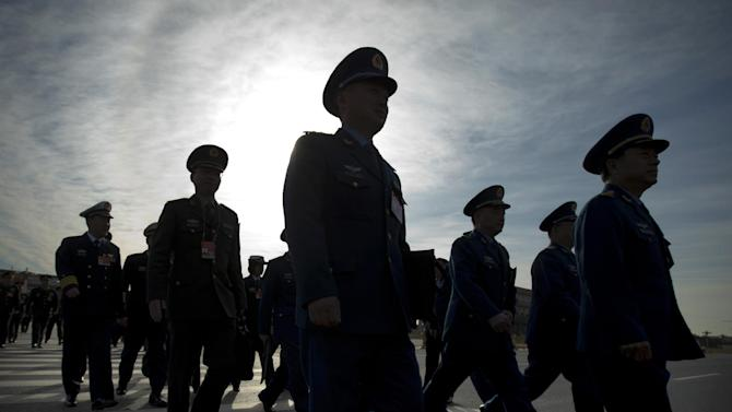 Chinese military officers arrive at the Great Hall of the People in Beijing Wednesday, March 4, 2015. China's military budget will grow by about 10 percent in the coming year, a legislative spokeswoman said Wednesday, despite slowing economic growth that fell to 7.4 percent last year and is expected to further decline in 2015. (AP Photo/Mark Schiefelbein)