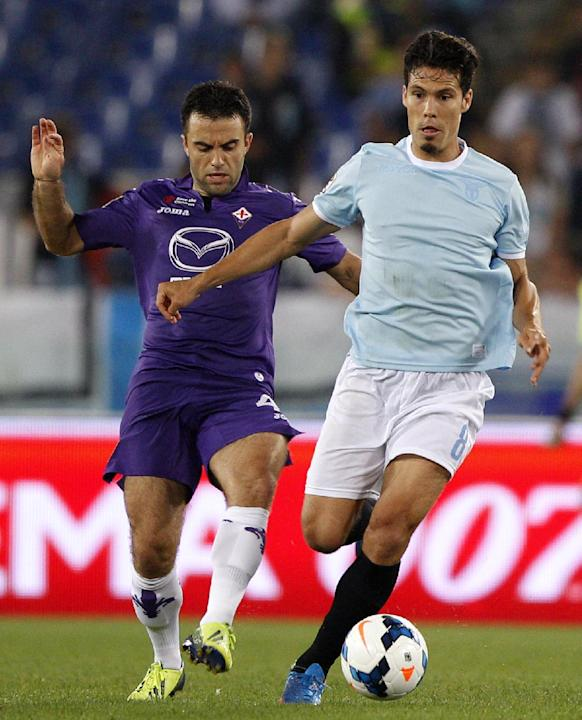 Lazio midfielder Hernanes, of Brazil, is challenged by Fiorentina forward Giuseppe Rossi, left, during a Serie A soccer match between Lazio and Fiorentina, at Rome's Olympic stadium, Sunday, Oct. 6, 2
