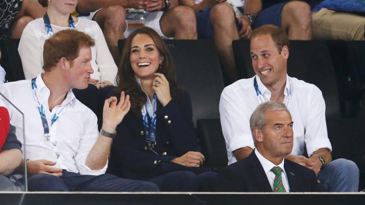 Catherine, Duchess of Cambridge, Prince William, Duke of Cambridge, and Prince Harry watch artistic gymnastics at the 2014 Commonwealth Games in Glasgow
