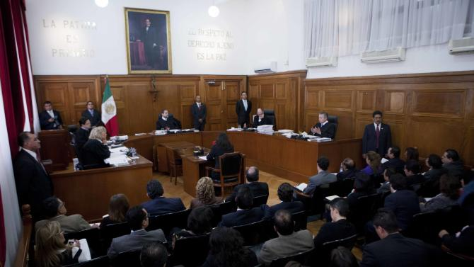 Supreme Court Justice ministers hold a panel hearing reviewing the case of French woman Florence Cassez in Mexico City, Wednesday, Jan. 23, 2013.  The Mexican Supreme Court panel voted Wednesday to release Cassez, who was sentenced to 60 years in prison for kidnapping. Cassez was arrested in 2005 and convicted of helping her Mexican then-boyfriend run a kidnap gang. The five-justice panel voted 3-2 to order Cassez released because of procedural and rights violations during her arrest.  (AP Photo/Eduardo Verdugo)