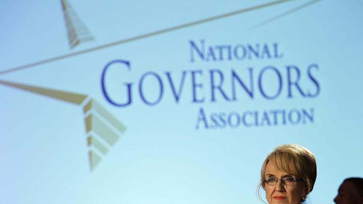 Arizona Gov. Jan Brewer attends the meeting of the Special Committee on Homeland Security and Public Safety panel during the National Governors Association winter meeting in Washington, on Sunday, Feb. 26, 2012. ( AP Photo/Jose Luis Magana)