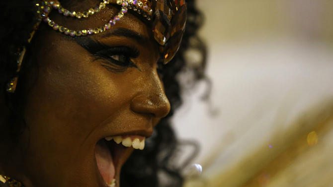 Mangueira samba school's Drum Queen Evelin performs during the carnival parade at the Sambadrome in Rio de Janeiro