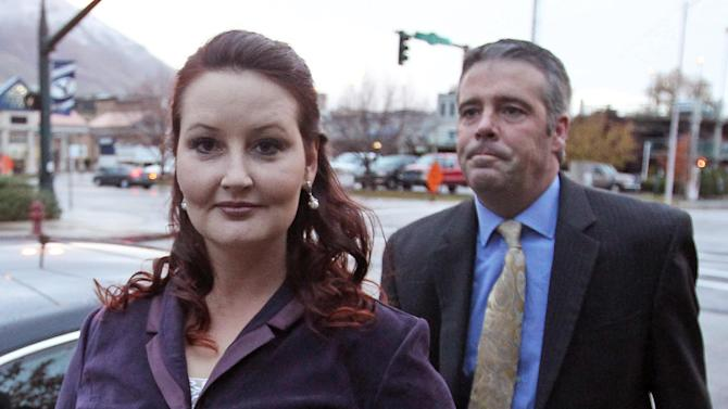 Gypsy Willis arrives at court Tuesday, Oct. 29, 2013, in Provo, Utah. The mistress of Martin MacNeill was at his murder trial Tuesday as prosecutors try to prove she was MacNeill's motive for leaving his heavily drugged wife to die in a bathtub. Prosecutors say they will press Gypsy Willis on what she knows about Michele MacNeill's 2007 death. Willis traded text messages with the doctor 30 times that day, she acknowledged Friday before the trial broke for a long weekend. (AP Photo/Rick Bowmer)