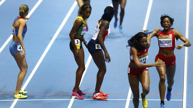 McCorory of U.S. passes baton to Tate in women's 4 x 400m relay final at world indoor athletics championships in Sopot