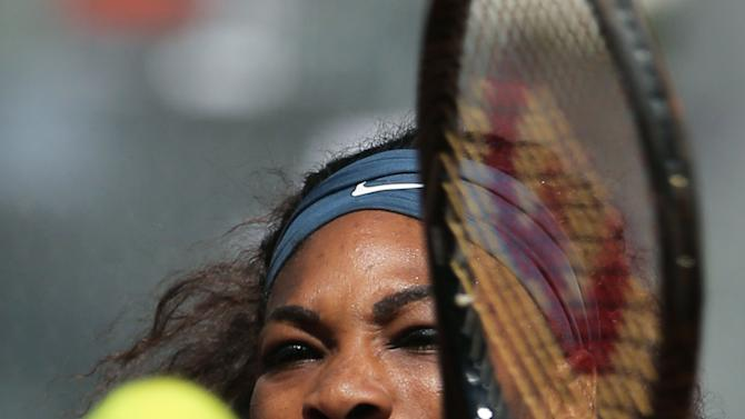 Serena Williams from U.S. returns a ball during the match against Sara Errani from Italy during the Madrid Open tennis tournament, in Madrid, Saturday, May 11, 2013. (AP Photo/Andres Kudacki)