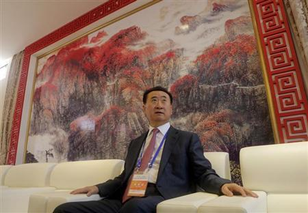 Wang, chairman of Chinese property developer Dalian Wanda Group, sits in a meeting room as he arrives for launch ceremony for Qingdao Oriental Movie Metropolis