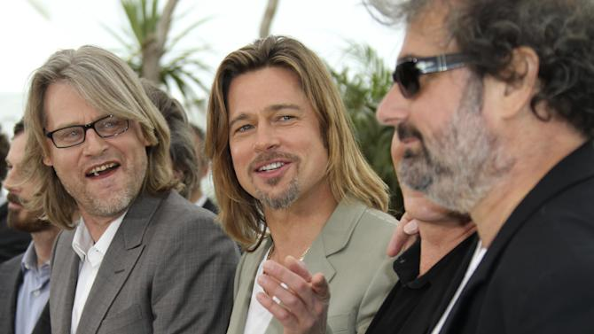 Director Andrew Dominik, left actor Brad Pitt, Ray Liotta, partially seen, and actor Gustave Kervern pose during a photo call for Killing Them Softly at the 65th international film festival, in Cannes, southern France, Tuesday, May 22, 2012. (AP Photo/Joel Ryan)