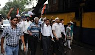 Activists from India Against Corruption (IAC) are seen during a protest against the arrest of cartoonist Aseem Trivedi, who was arrested on sedition charges, outside Arthur Road Jail in Mumbai, on September 11. Trivedi is expected to accept bail terms and leave prison on Wednesday, his lawyer said, in a case that has outraged freedom of expression campaigners