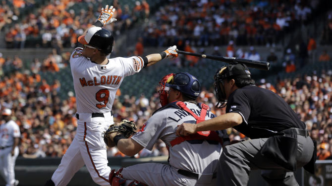 Baltimore Orioles' Nate McLouth, left, watches his solo home run in the first inning of a baseball game against the Boston Red Sox in Baltimore, Sunday, Sept. 30, 2012. (AP Photo/Patrick Semansky)