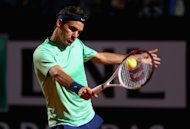 ROME, ITALY - MAY 17:  Roger Federer of Switzerland in action during his quarter final match against Jerzy Janowicz of Poland on day six of the Internazionali BNL d&#39;Italia 2013 at the Foro Italico Tennis Centre  on May 17, 2013 in Rome, Italy.  (Photo by Clive Mason/Getty Images)