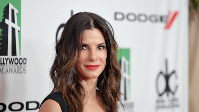 """FILE - In this Oct. 21, 2013 file photo, Sandra Bullock arrives at the 17th Annual Hollywood Film Awards Gala at the Beverly Hilton Hotel in Beverly Hills, Calif. Bullock scored five nominations for the People's Choice Awards airing on CBS, Wednesday, Jan. 8, 2014. The """"Gravity"""" star is nominated for favorite comedic and dramatic actress and also gained two nominations for favorite duo. (Photo by John Shearer/Invision/AP, file)"""