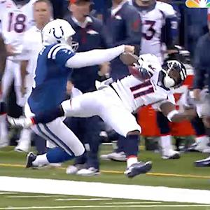 Indianapolis Colts kicker Pat McAfee lays out kick returner Trindon Holliday