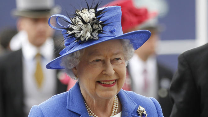 Britain's Queen Elizabeth II arrives for the Epsom Derby at Epsom race course, southern England at the start of a four-day Diamond Jubilee celebration to mark the 60th anniversary of  the Queen's accession to the throne Saturday, June 2, 2012. (AP Photo/Sang Tan)