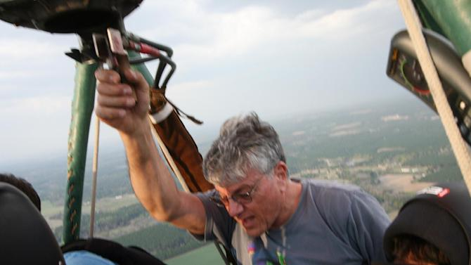 In this Friday, March 16, 2012 photo provided by Brian Wesnofske, pilot Ed Ristaino, 63, speaks to skydivers in his hot-air balloon over Fitzgerald, Ga. Later, Ristaino would tell his five passengers to bail out just before a thunderstorm sucked in his craft and sent him plummeting to his death. Searchers found his body Monday, March 19, 2012 after combing the woods in south Georgia with helicopters, airplanes, horses and all-terrain vehicles. (AP Photo/Brian Wesnofske)